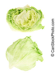 Whole and sliced green cabbage isolated over white...