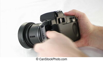 Loading SLR Camera - Loading film into a SLR camera.