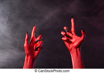 Creepy red devil hands with black sharp nails - Creepy red...