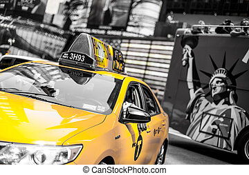 Yellow cab speeds through Times Square in New York, NY, USA....