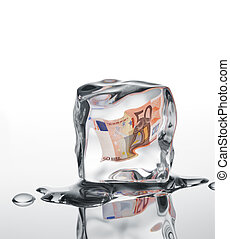 financial crisis - euro banknote frozen in ice cube,...