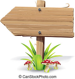 Wooden arrow on grass and mushroom. - Wooden arrow sign on a...