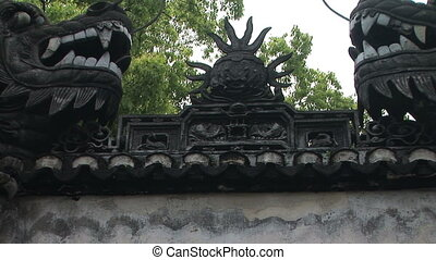 Dragons sitting on a wall - Two bronze dragons on a garden...