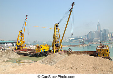Reclamation in Hong Kong - Construction Ships working on a...