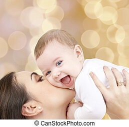 laughing baby playing with mother - family, child and...