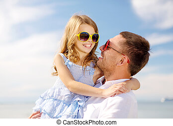 happy father and child girl having fun outdoors - summer...