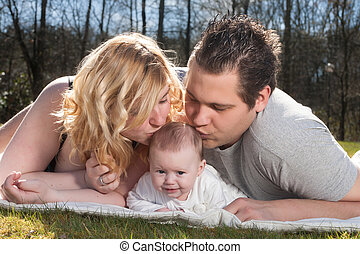 Family love - Young family is having nice time with their...