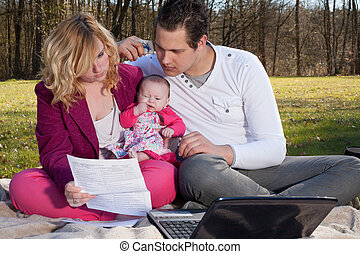 Young family busy with financials - Young family is having...