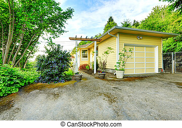 House exterior. View of garage and driveway - Yellow one...
