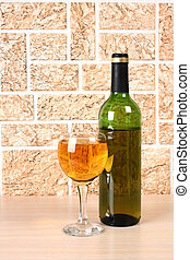 Wineglass on brick - Wine bottle and glass on brick wall...