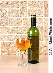 Wineglass on brick - Wine bottle and glass on brick wall...