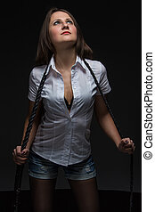 Girl with whip in shadow - girl weared shirt and shorts