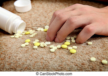 Hand near the scattering Pills - Hand near the scattered...