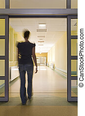 Woman entering a hospital - Young women entering a hospital...