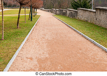 Red gravel path in the park