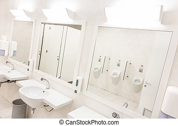 White public tilet - Public empty white man restroom with...