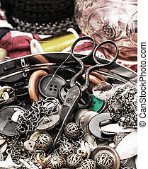 sewing tool - buttons and zipper on the background of sewing...