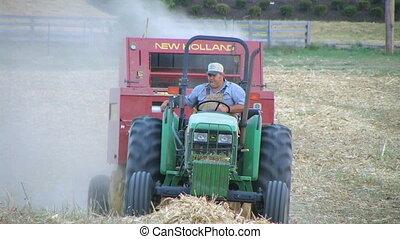 Farmer Baling Hay - Farmer round baling hay