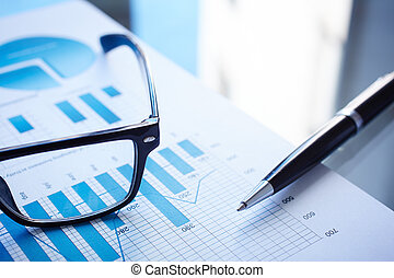 Business data - Image of eyeglasses, pen and financial...