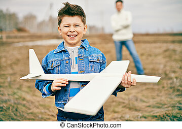 Boy with airplane
