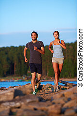 Dates jogging - Photo of happy young couple running outdoors