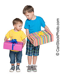 Two boys hold gift boxes on the white background