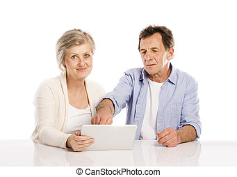 Senior couple with tablet