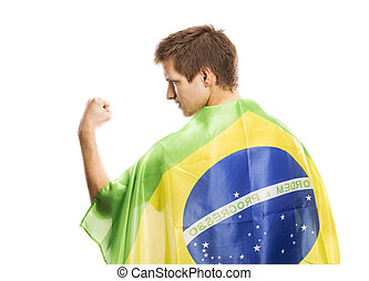 Male soccer fan - Brazilian soccer fan holding the flag of...