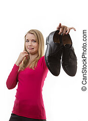 Dirty Smelly shoes - woman holding up men's smelly shoes,...