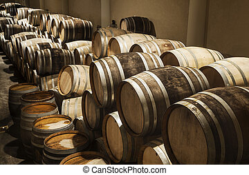 Wine Barrels - Wine barrels stacked in cellar area