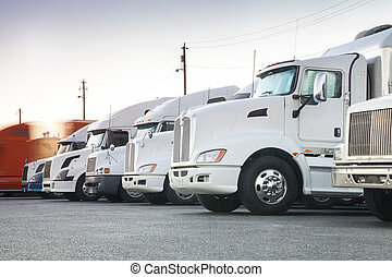 Different american trucks in a row with one which has just...