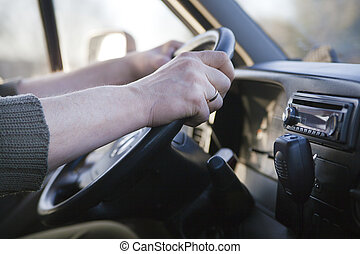 Truck Driver - Steering Wheel and hands of Truck Driver