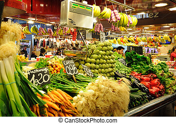 Fruits and vegetables stand in La Boqueria market, Barcelona...