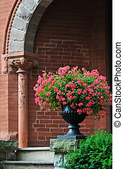 Old brick house with flower pot - Old brick house in the...
