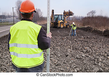 Building a road - Surveyors at work - Surveyors at work with...