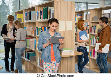 College student using tablet in library