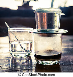 Vietnamese drip coffee - Coffee brewed in traditional...