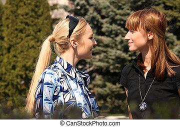 women friends meet in a park
