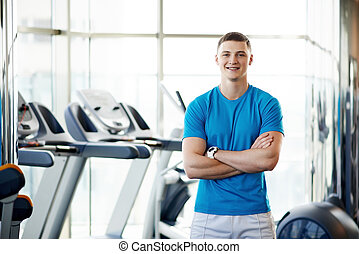 trainer at the gym - young coach in the gym
