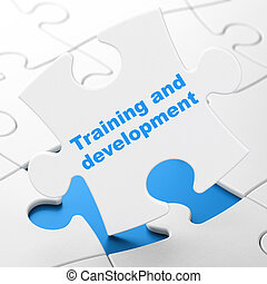 Education concept: Training and Development on White puzzle...