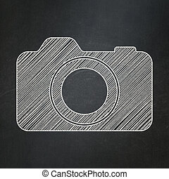 Tourism concept: Photo Camera on chalkboard background -...
