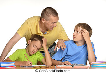 Kids doing homework with father - Father is helping their...