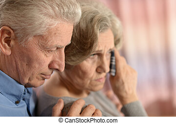Romantic elderly couple - Romantic sad elderly couple...
