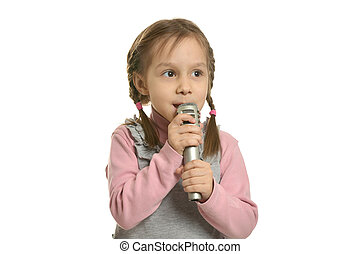 Little girl singing - Little girl singing with microphone on...