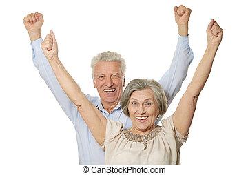 Emotional senior couple isolated on white background