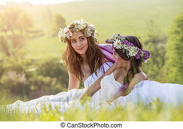 2 Beautiful bride in the outdoor, sitting on the grass - idyllic