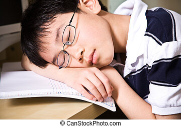 Sleeping young student - A shot of an asian student falling...
