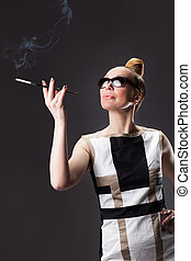 Attractive young adult woman with cigarette