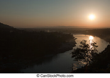 Sunset over The Ganges in Rishikesh, India.