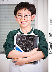 Young student - A shot of an asian kid carrying books